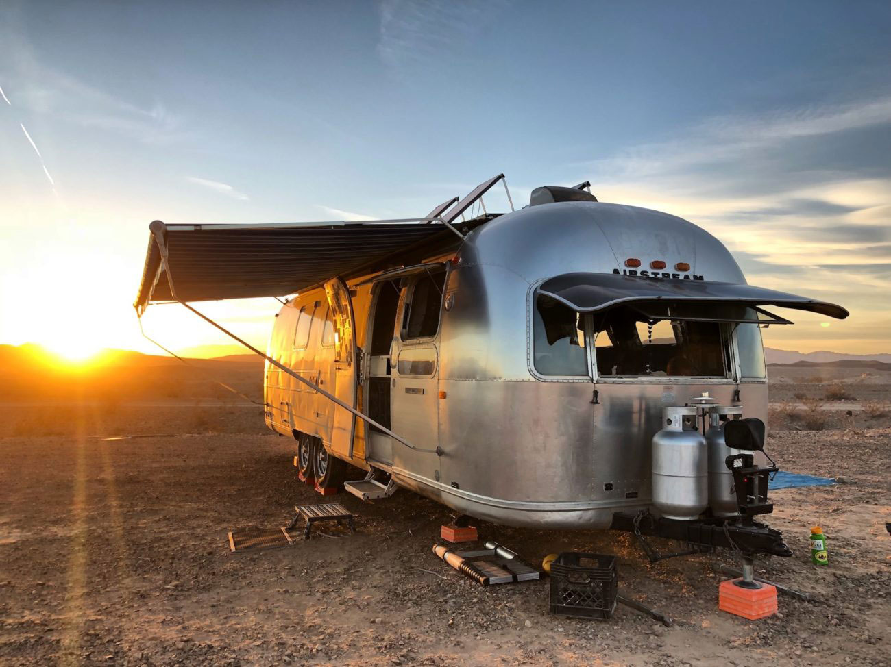 Metallic solar Airstream RV with Blue Sky Energy controllers charging in desert