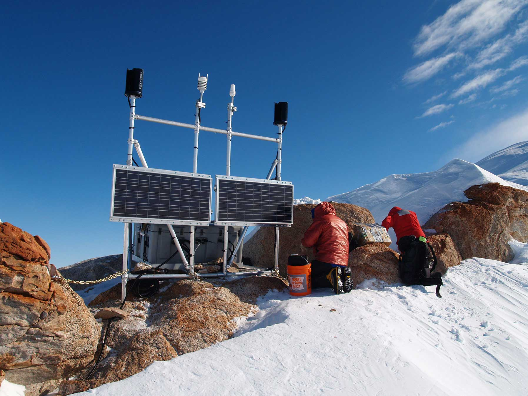 Genasun controllers attached to solar panels in snowy Arctic, suitable for harsh weather conditions with C1D2 classification