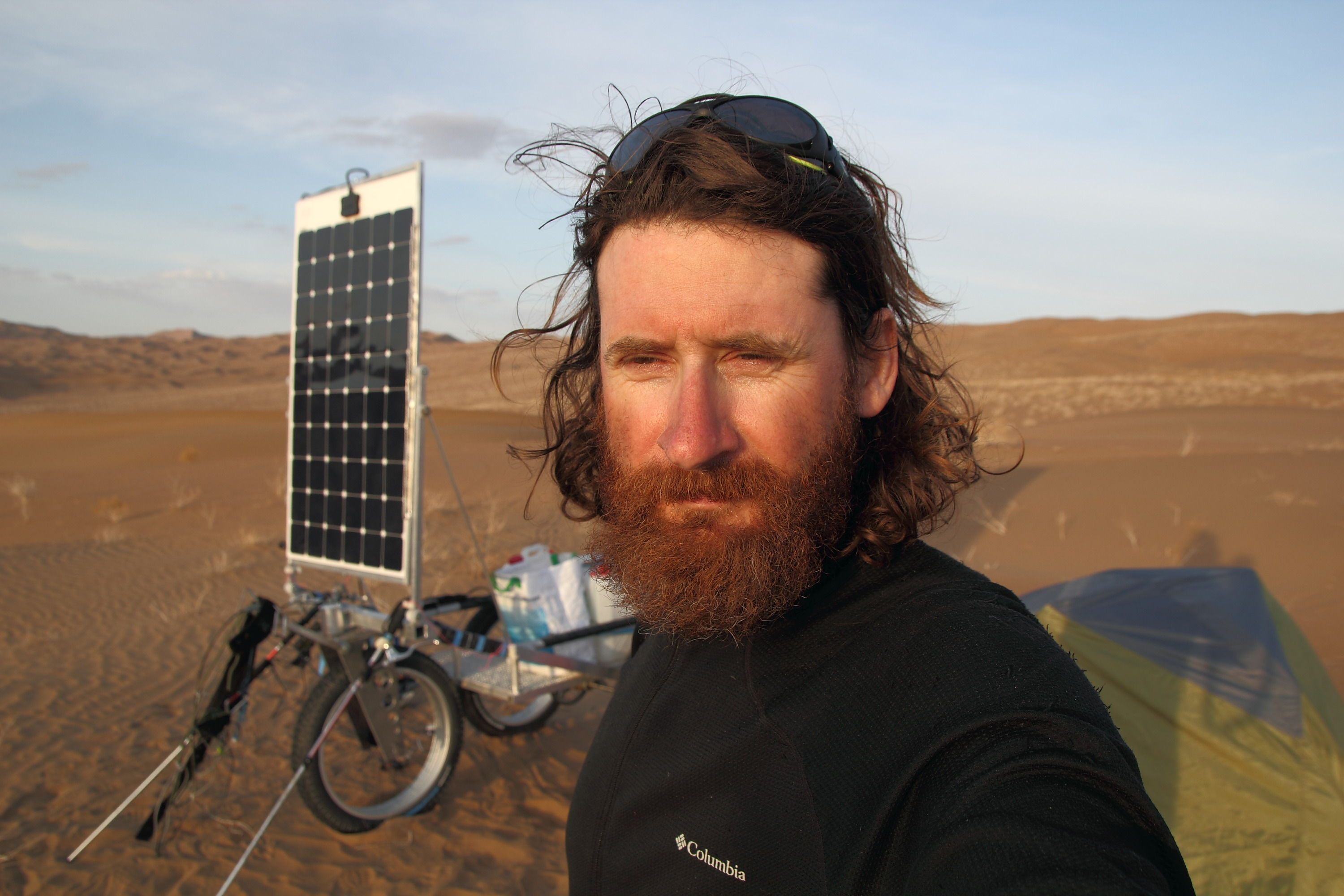 Olivier Coste selfie with his solar-powered cart with genasun controllers
